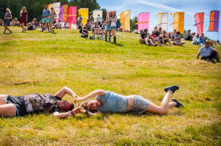 Girls rolling down the hill at Glastonbury 2015
