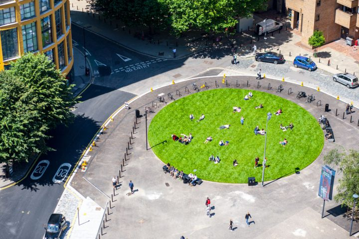 Sun bathing London style on the circular lawn near Tate Modern
