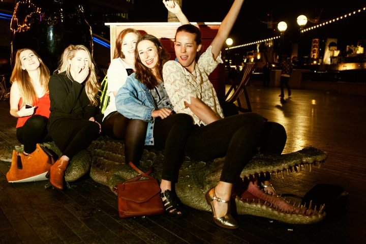 Five young women on a crocodile