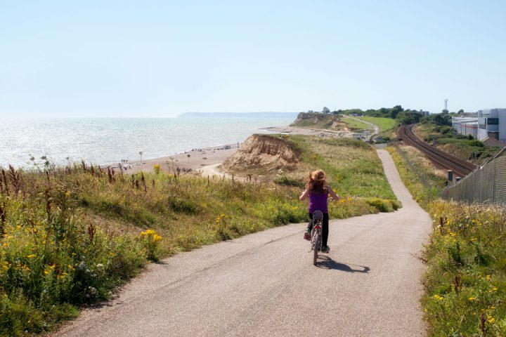 Girl freewheeling on a chopper on the coastal path to Bexhill